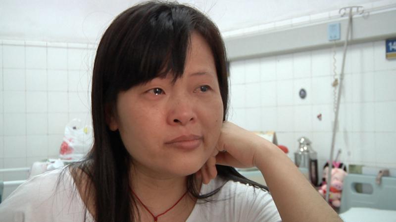 Campagne d'Action de Carême et de Pain pour le prochain 'Le benzène tue!' Les souffrances de l'ouvrière ZengPing  (Photo:  AdC/PPP)